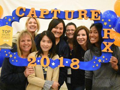 CaptureRx employees with a 2018 banner